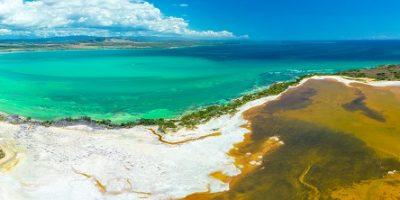 Aerial_view_of_Puerto_Rico._Faro_Los_Morrillos_de_Cabo_Rojo._Playa_Sucia_beach_and_Salt_lakes_in_Punta_Jaguey